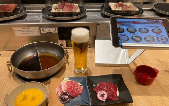 shabu shabu japon restaurant tapis roulant